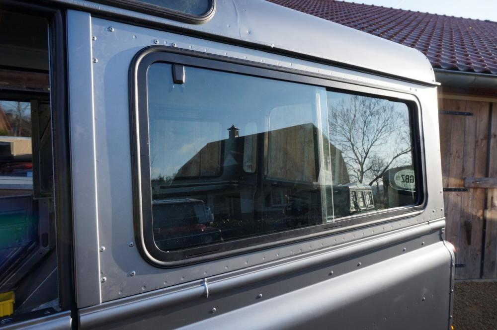 Click image for larger version  Name:1983 110 White Saudie Spec V8 painted Frozen Grey day 4 building sliding side glass.jpg Views:723 Size:81.3 KB ID:87750