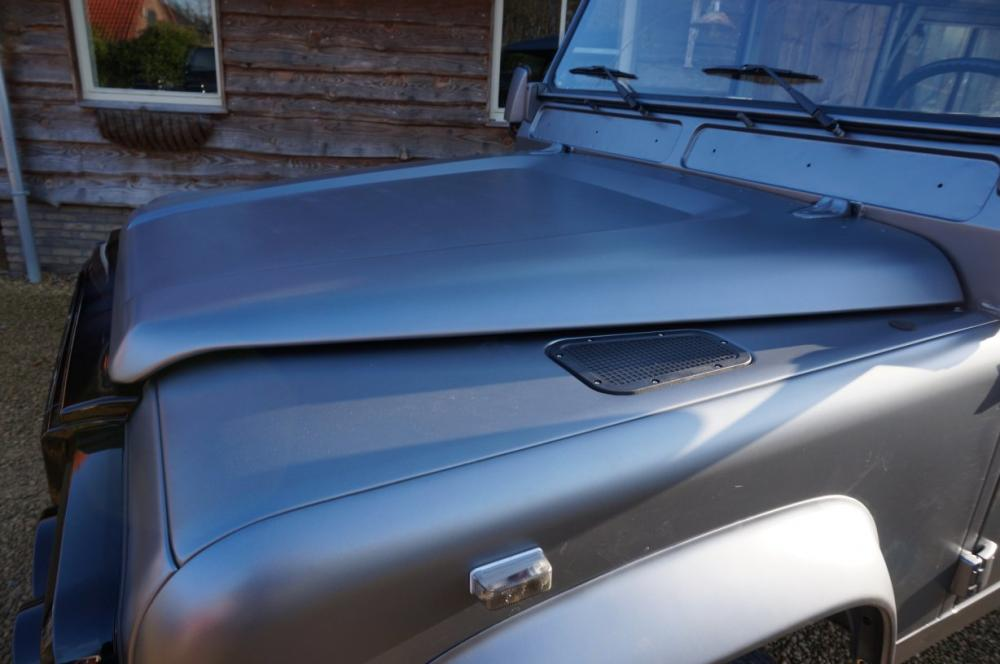 Click image for larger version  Name:1983 110 White Saudie Spec V8 painted Frozen Grey day 4 hood and ac bulkhead.jpg Views:785 Size:59.3 KB ID:87745