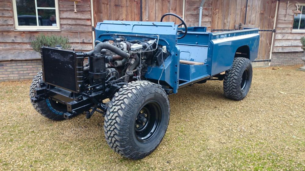 Click image for larger version  Name:1988 Land Rover Defender 110 soft top LHD Arles Blue 2.5 Td day 2 left front.jpg Views:634 Size:136.6 KB ID:107400