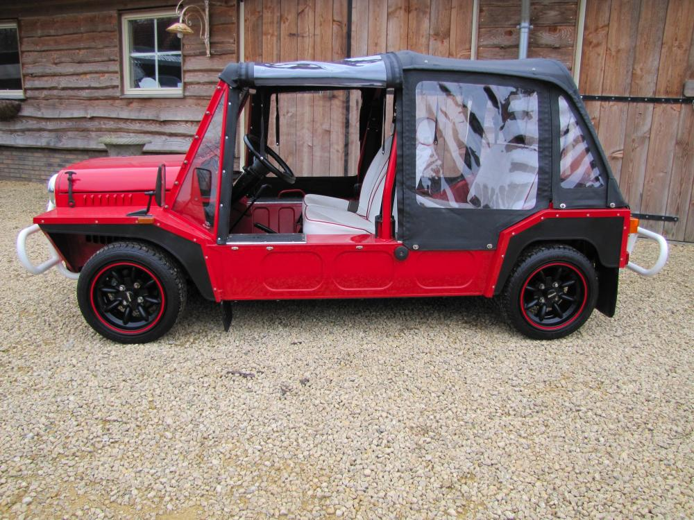 Click image for larger version  Name:1988 Red Black Mini Moke Port. left side.jpg Views:594 Size:159.2 KB ID:50554