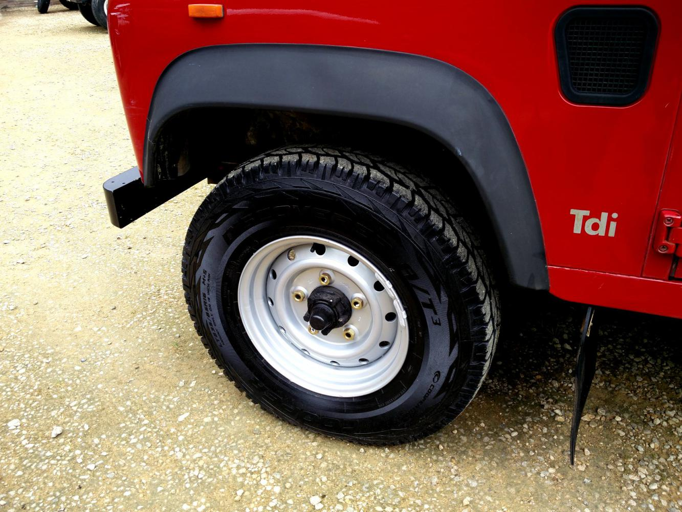 Click image for larger version  Name:1992 LR LHD Defender 90 Red 200 Tdi WOLF rims with new tyres.jpg Views:155 Size:202.6 KB ID:263714