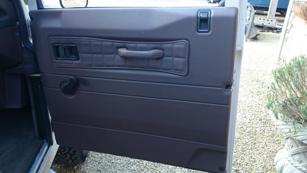 Click image for larger version  Name:2001 LR LHD 110 Td5 Soft Top Latte doortrim front.jpg Views:181 Size:66.8 KB ID:118960